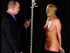 Sexy lady in silk dress is bound in place by stranger