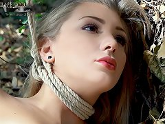 Slutty teen girl is bound and tormented in the woods