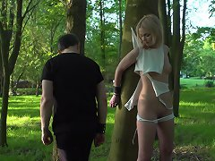 Amazing blonde whipped in the forest
